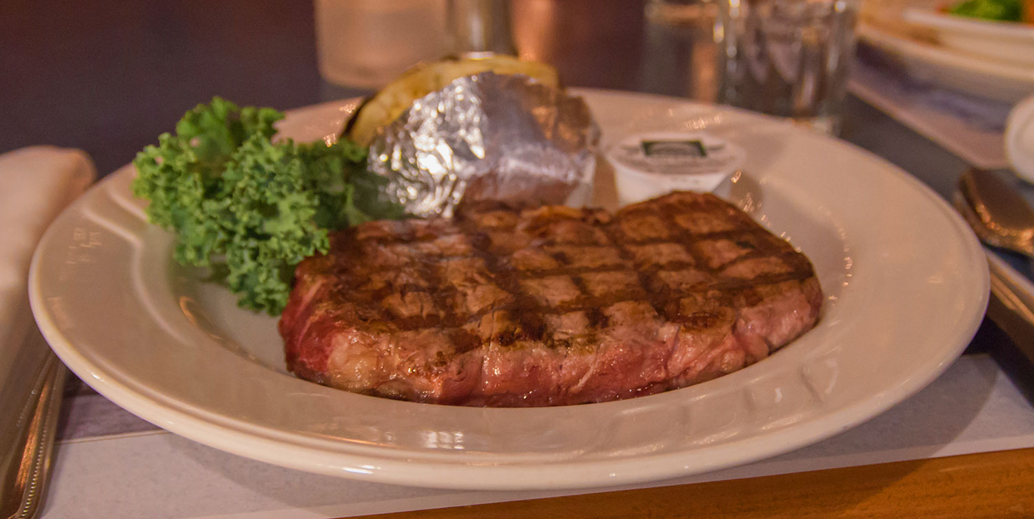 steak with baked potato - Castle Hill Supper Club - restaurant and banquet facility