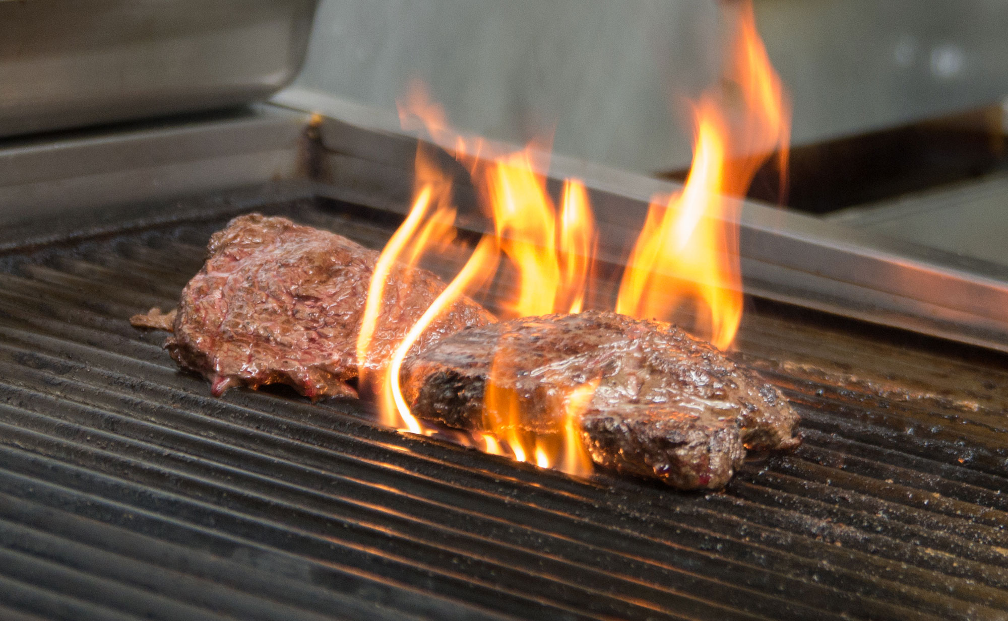 Steaks on the grill - Castle Hill Supper Club - restaurant and banquet facility